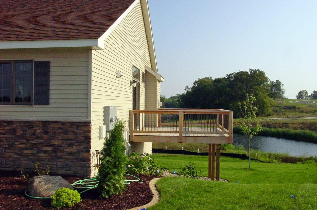 Large raised deck overlooking pond