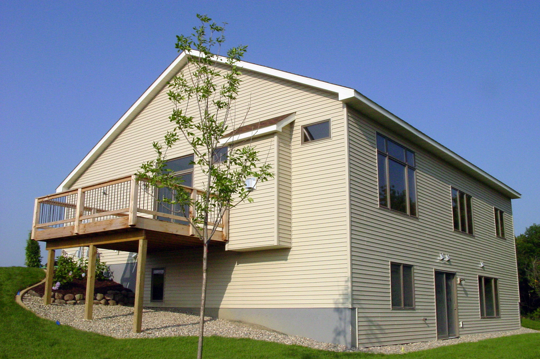 Large raised deck on side of house