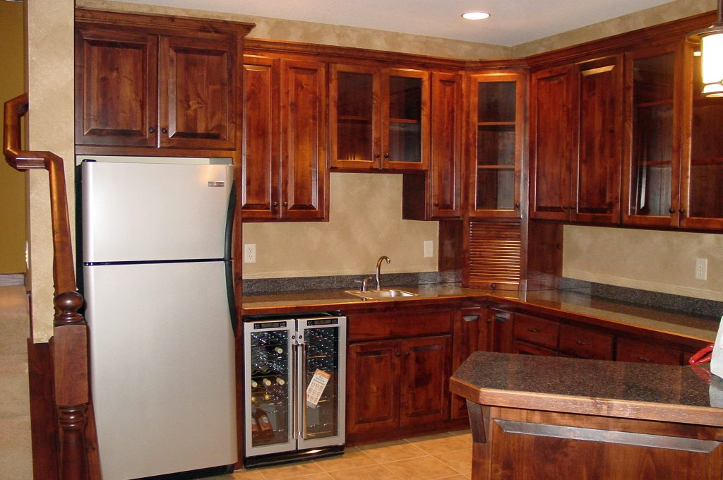 Lower level kitchen with wood cabinets