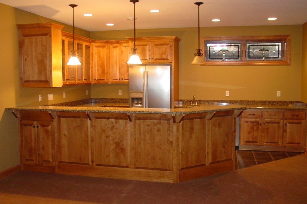 New kitchen with wood cabinets and stone countertops