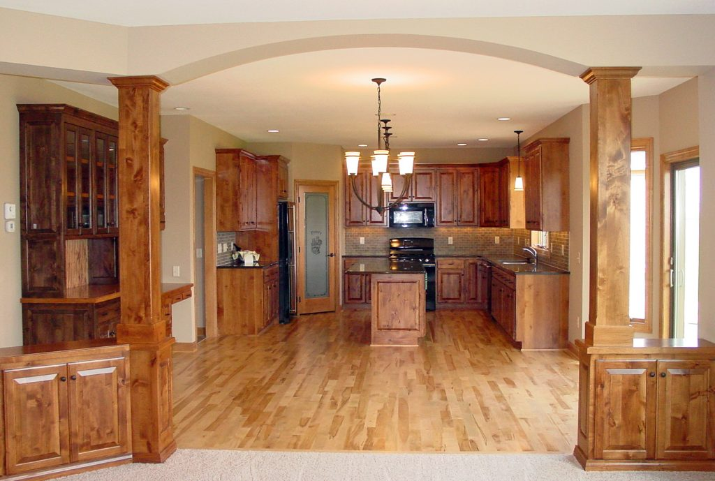 New kitchen with wood cabinets and hardwood floors