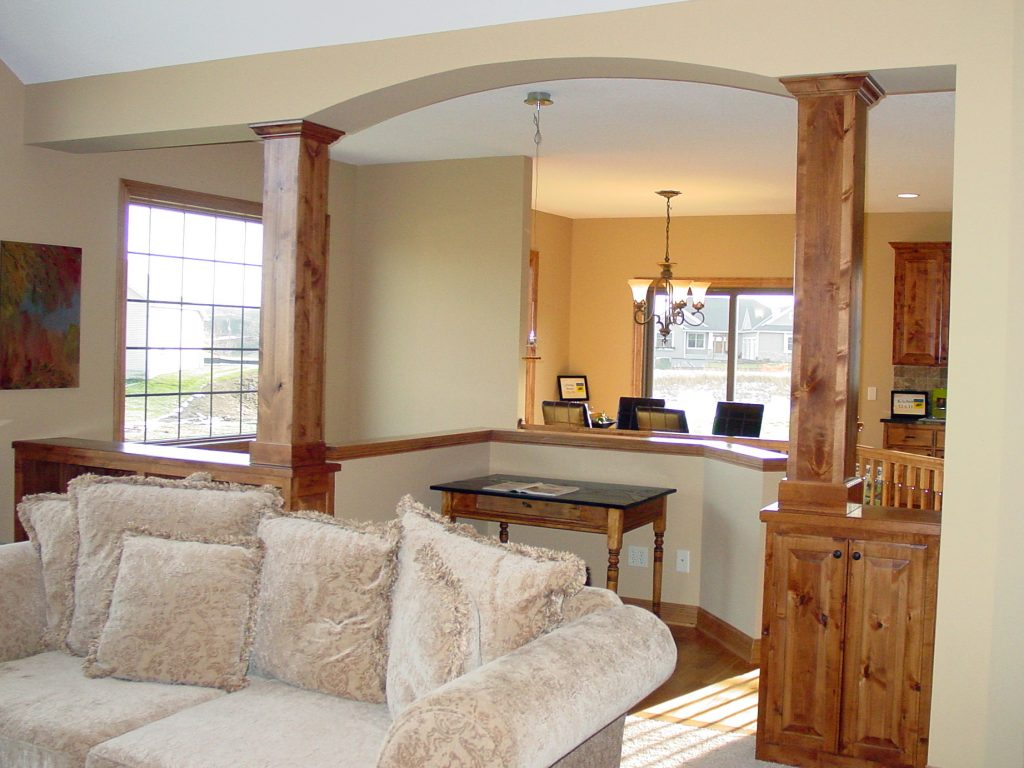 Arched living room with view to dining room