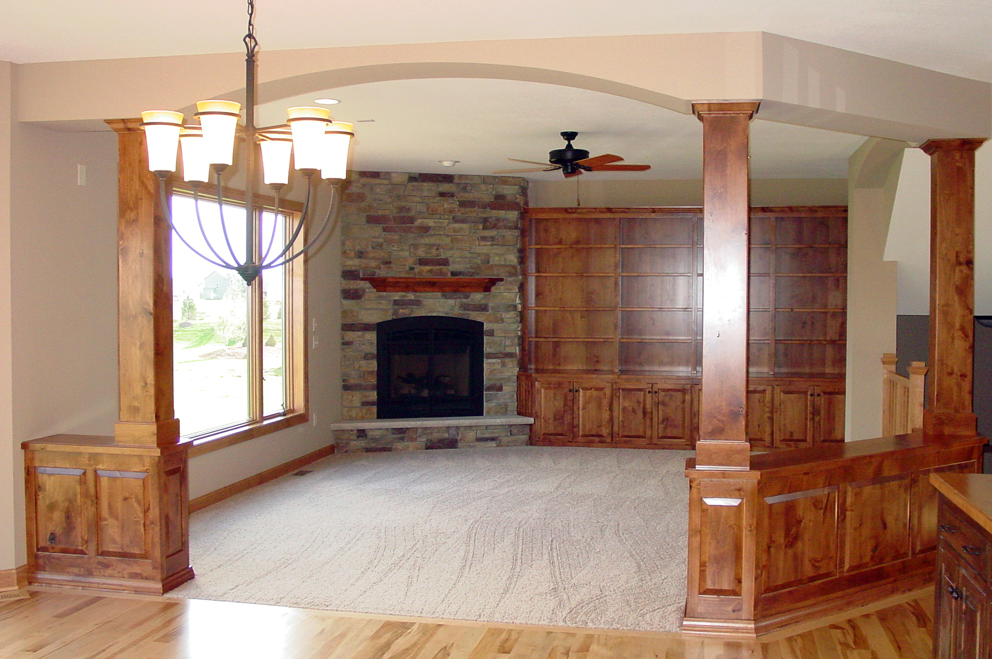 Living room with wood built-ins and stone fireplace