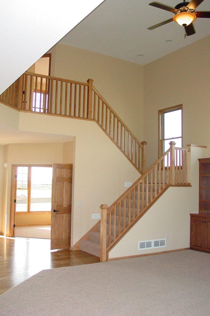Stairway with wood railings