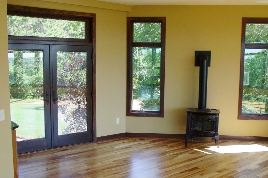 Enclosed porch with hardwood floors and stove