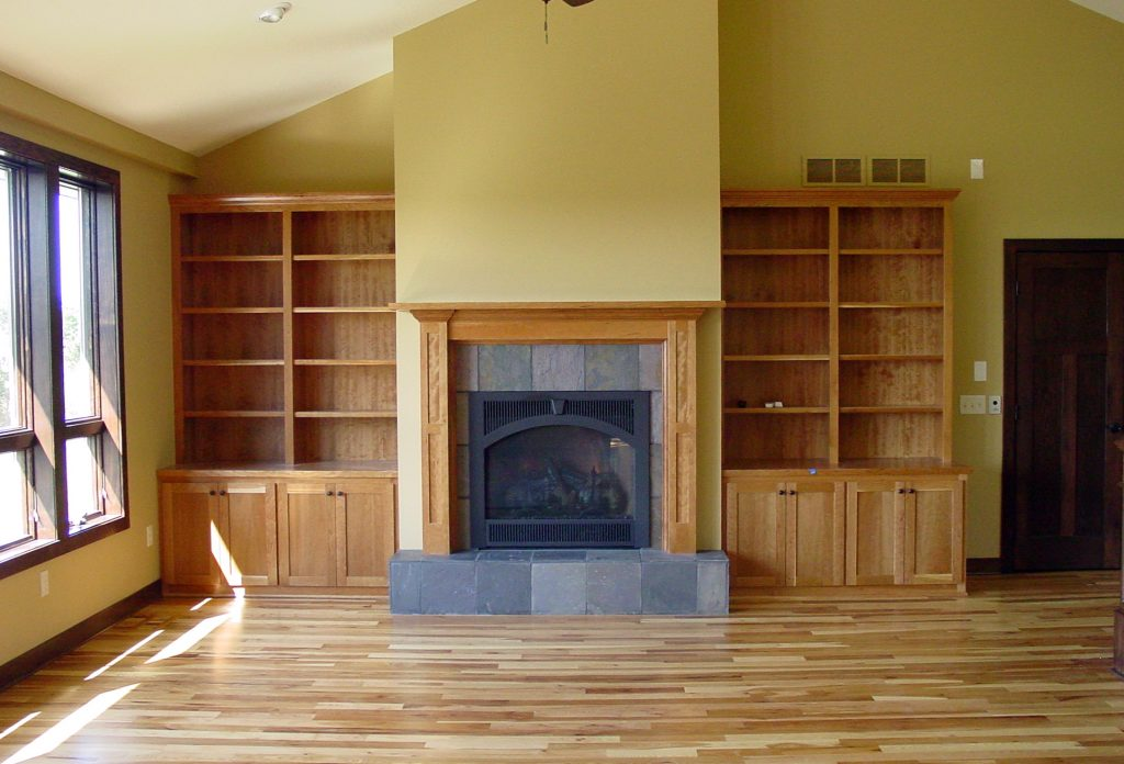 Living room with wood built-ins, hardwood floors and fireplace