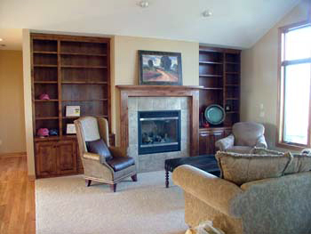 Living room with wood built-ins and fireplace