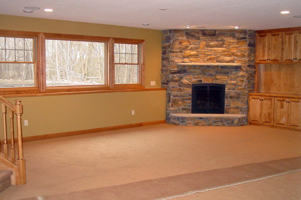 Lower level family room with stone fireplace