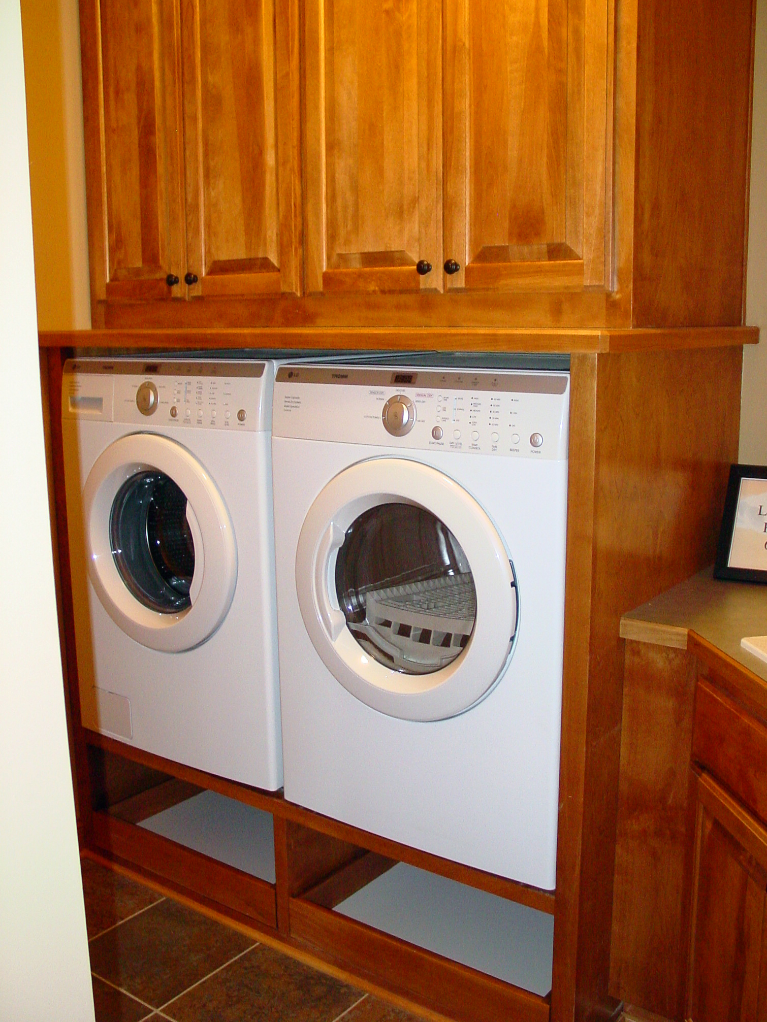 Laundry room with wood built-ins