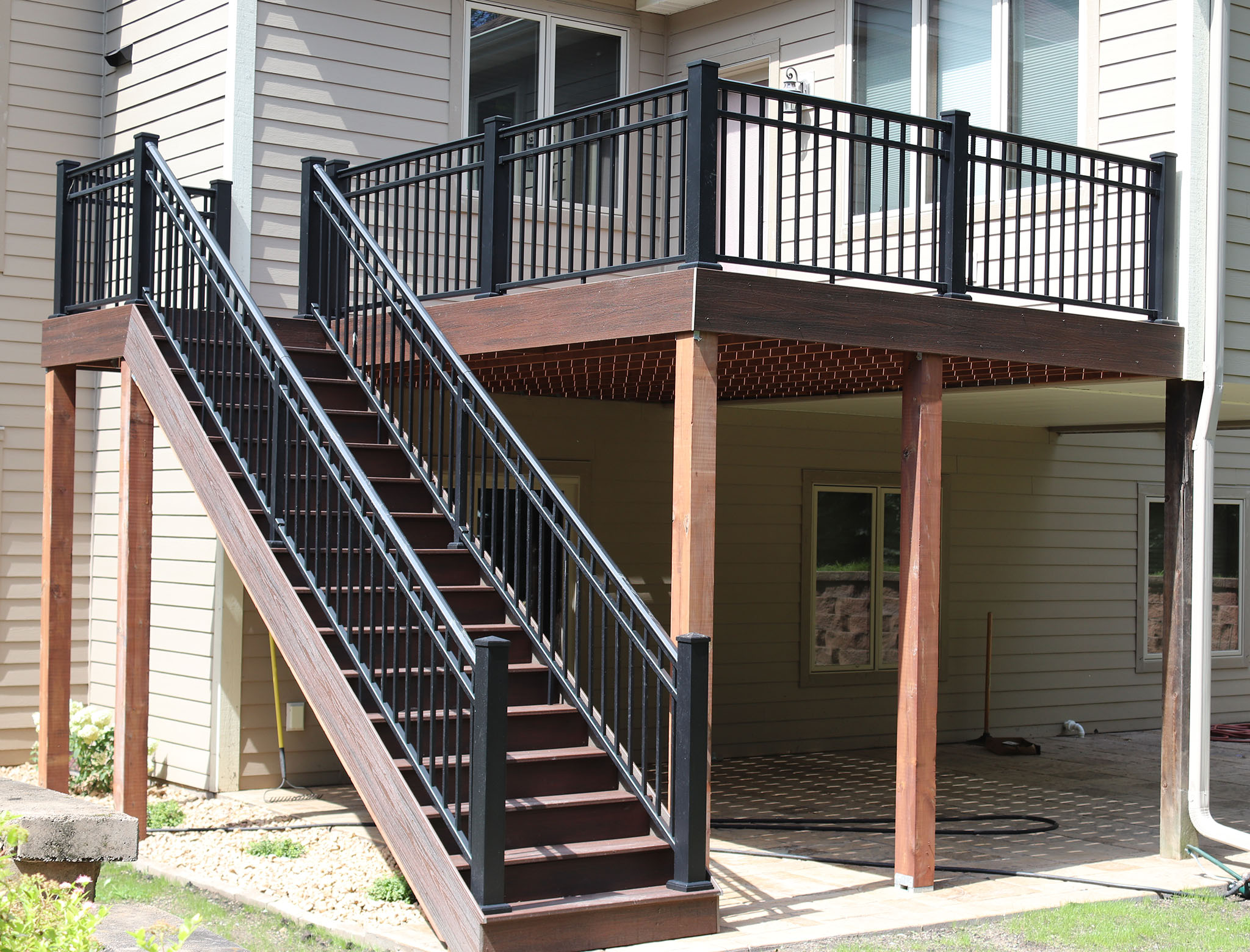 Trex composite decking with square metal balusters and railing, stairway to ground elevation