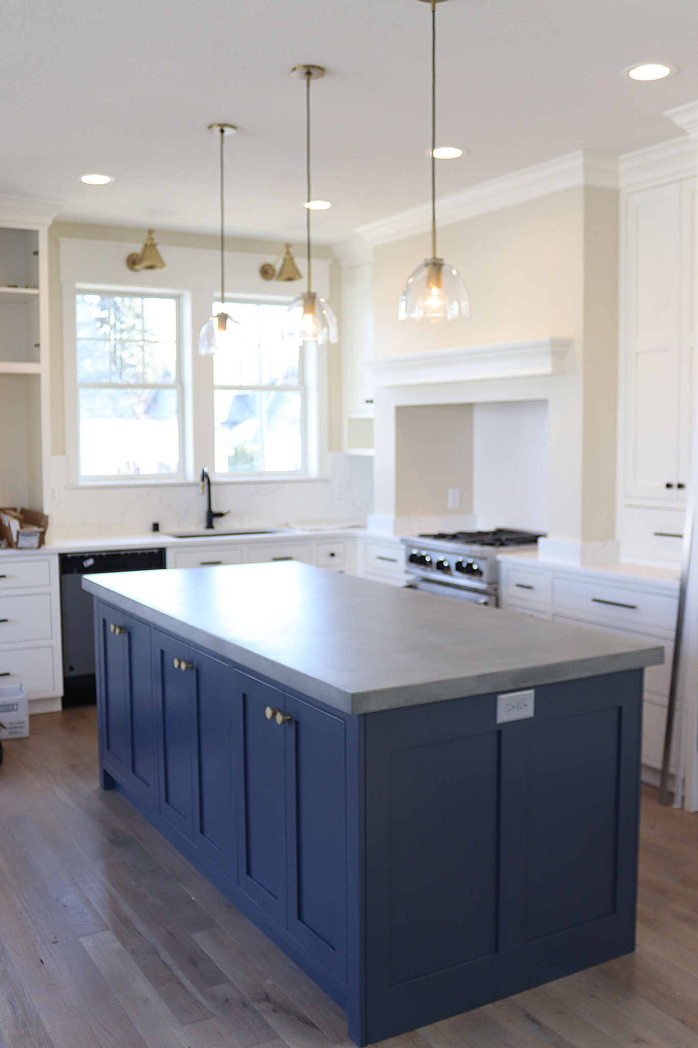 Concrete countertop island with ample cabinet storage