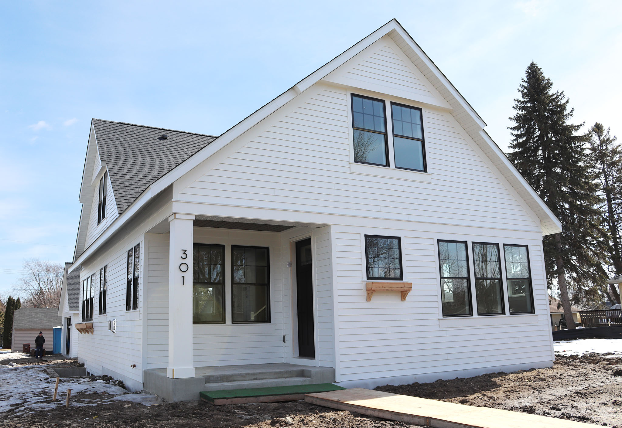 Quaint city lot 1-1/2 story house with LP Smartside and Marvin windows with black trim