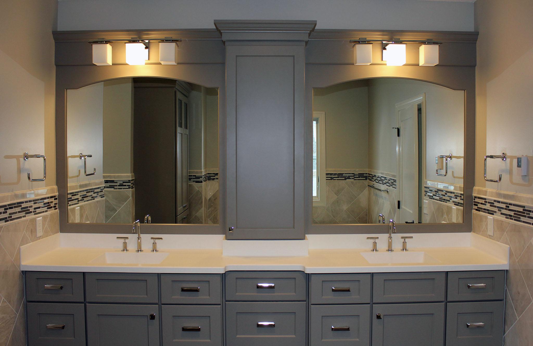 Master bath with painted poplar cabinets, tile backsplash, arched mirror frames