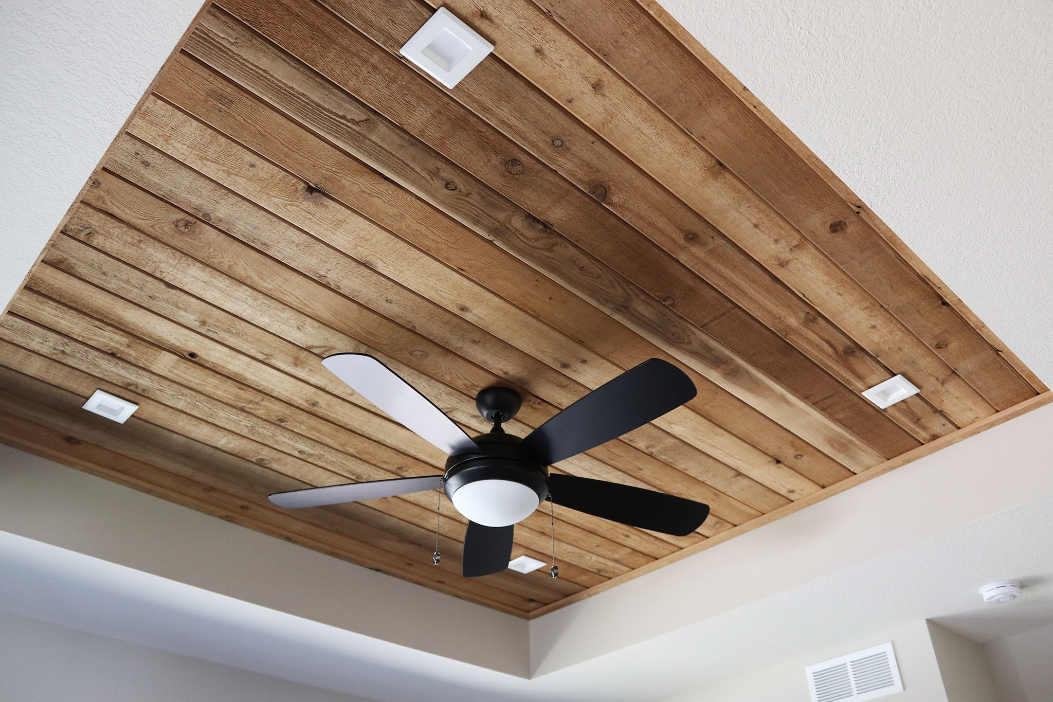 Tray ceiling with stained wood plank inset