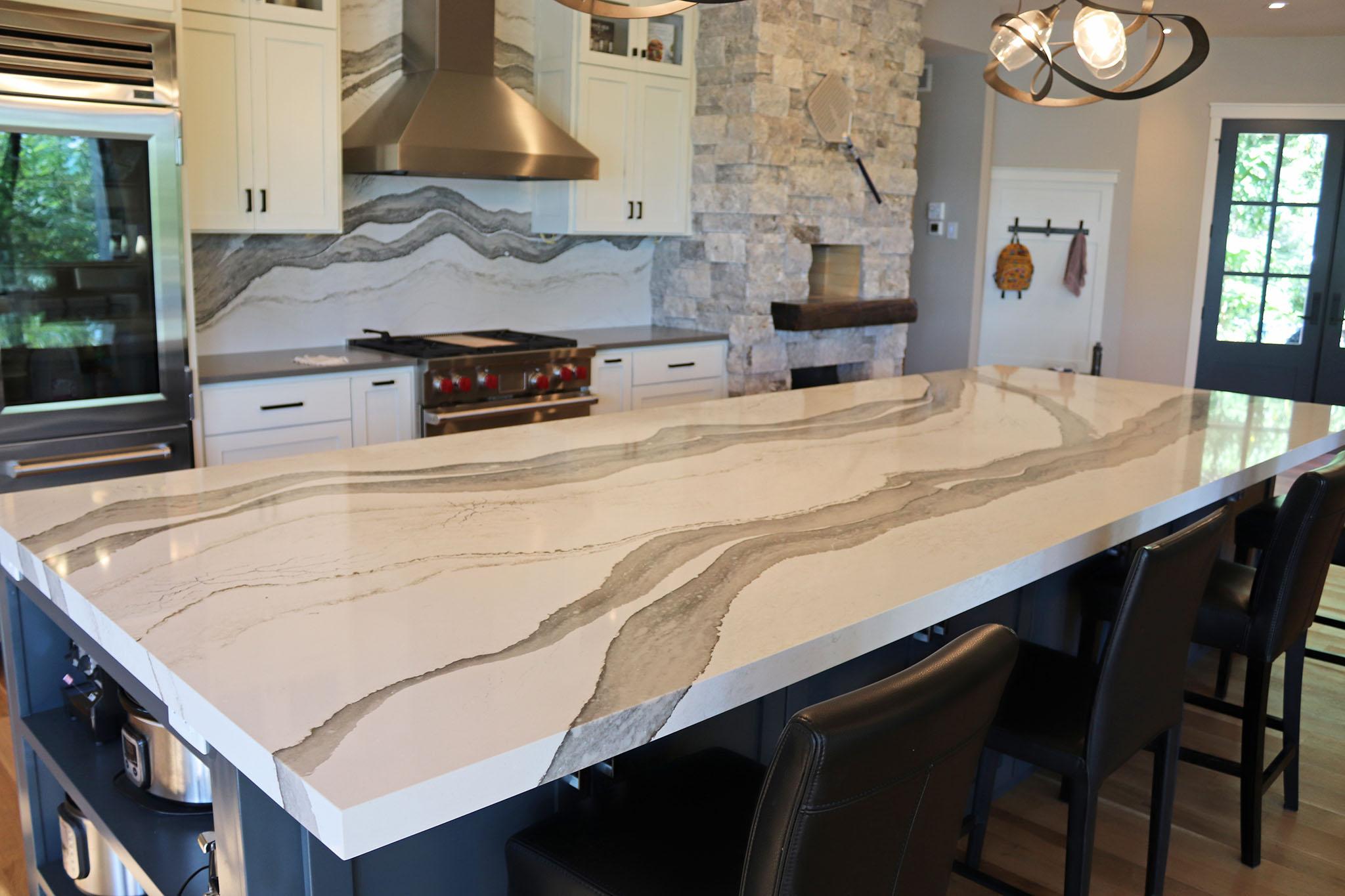 Closeup of kitchen island with digitally designed quartz vein in Cambria countertop