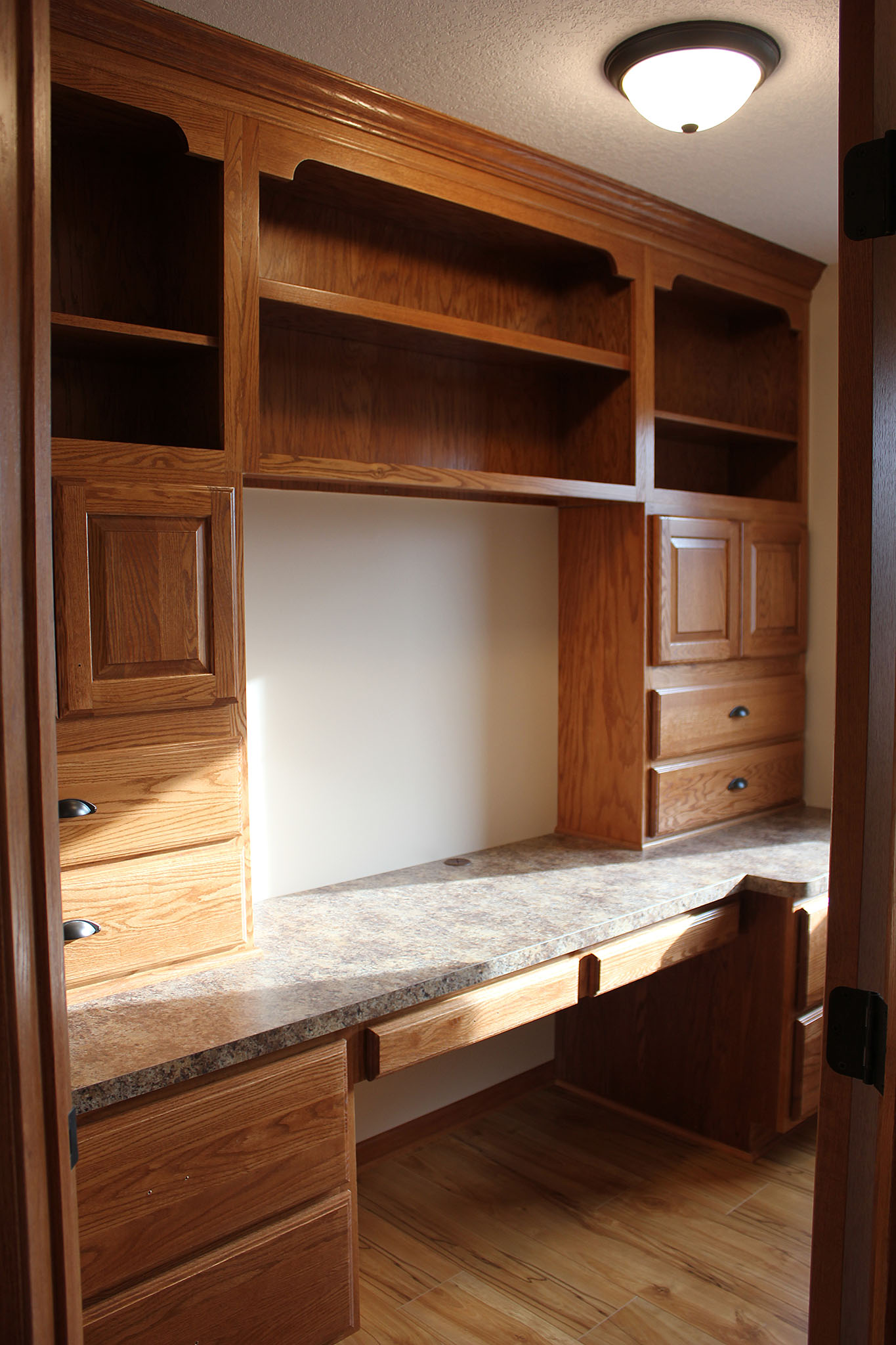 Twin home office with built-in cabinets and shelving