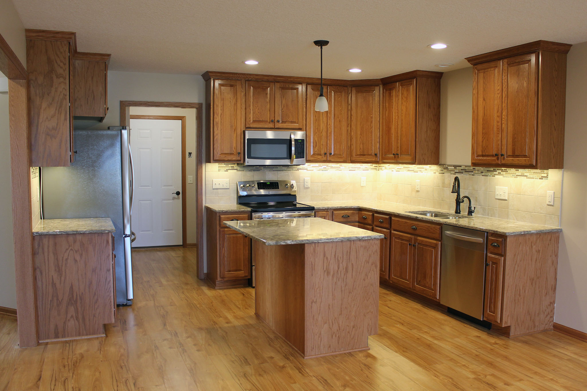 Kitchen with wood cabinets and stainless appliances