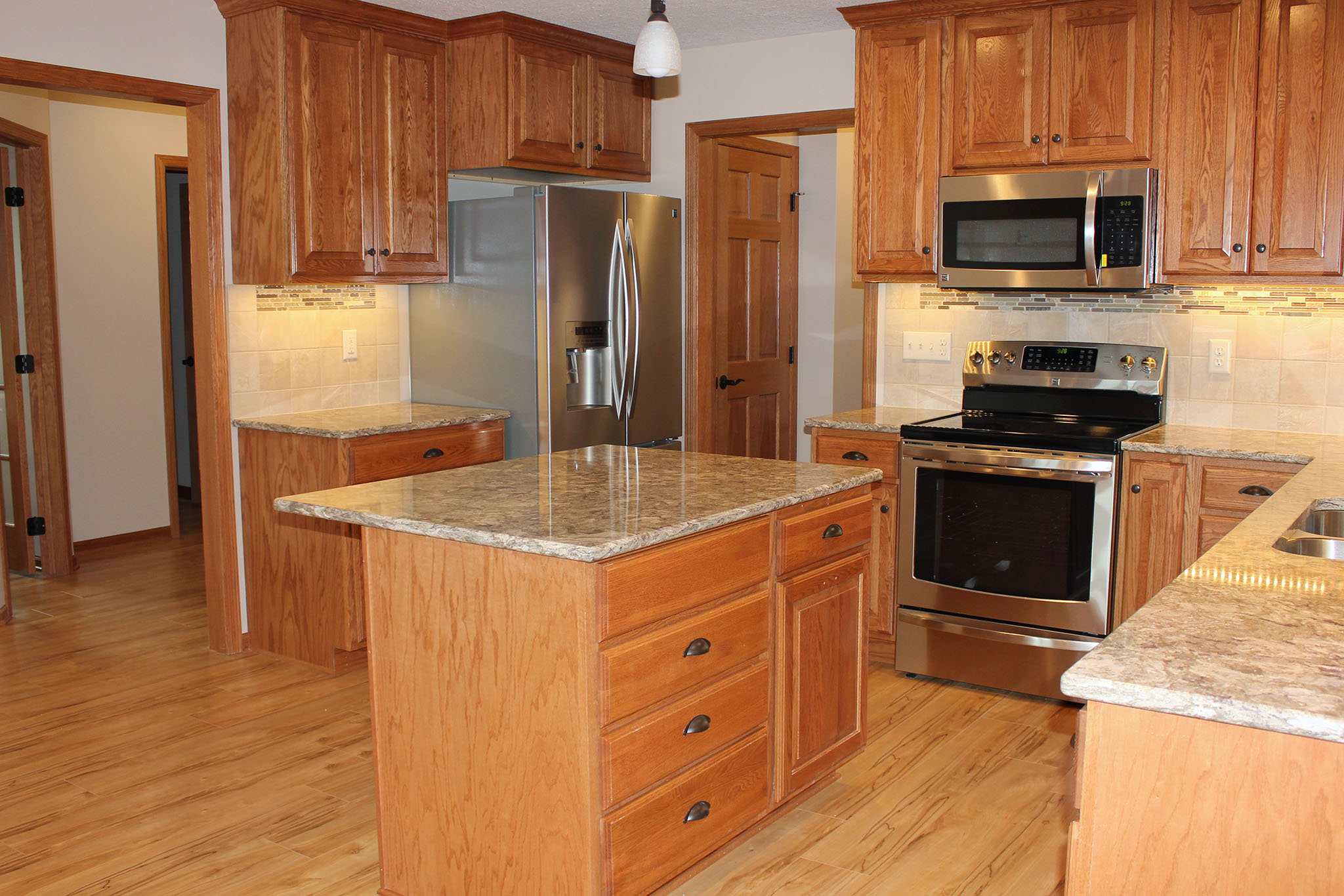 Bright kitchen with wood cabinets