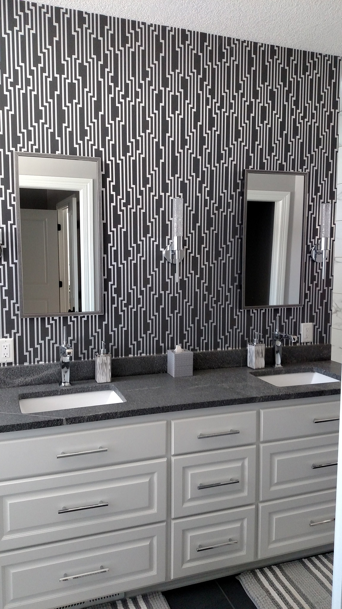 Contemporary master bath white vanity with gray marble tops and backsplash, square undermount sinks and patterned wallpaper