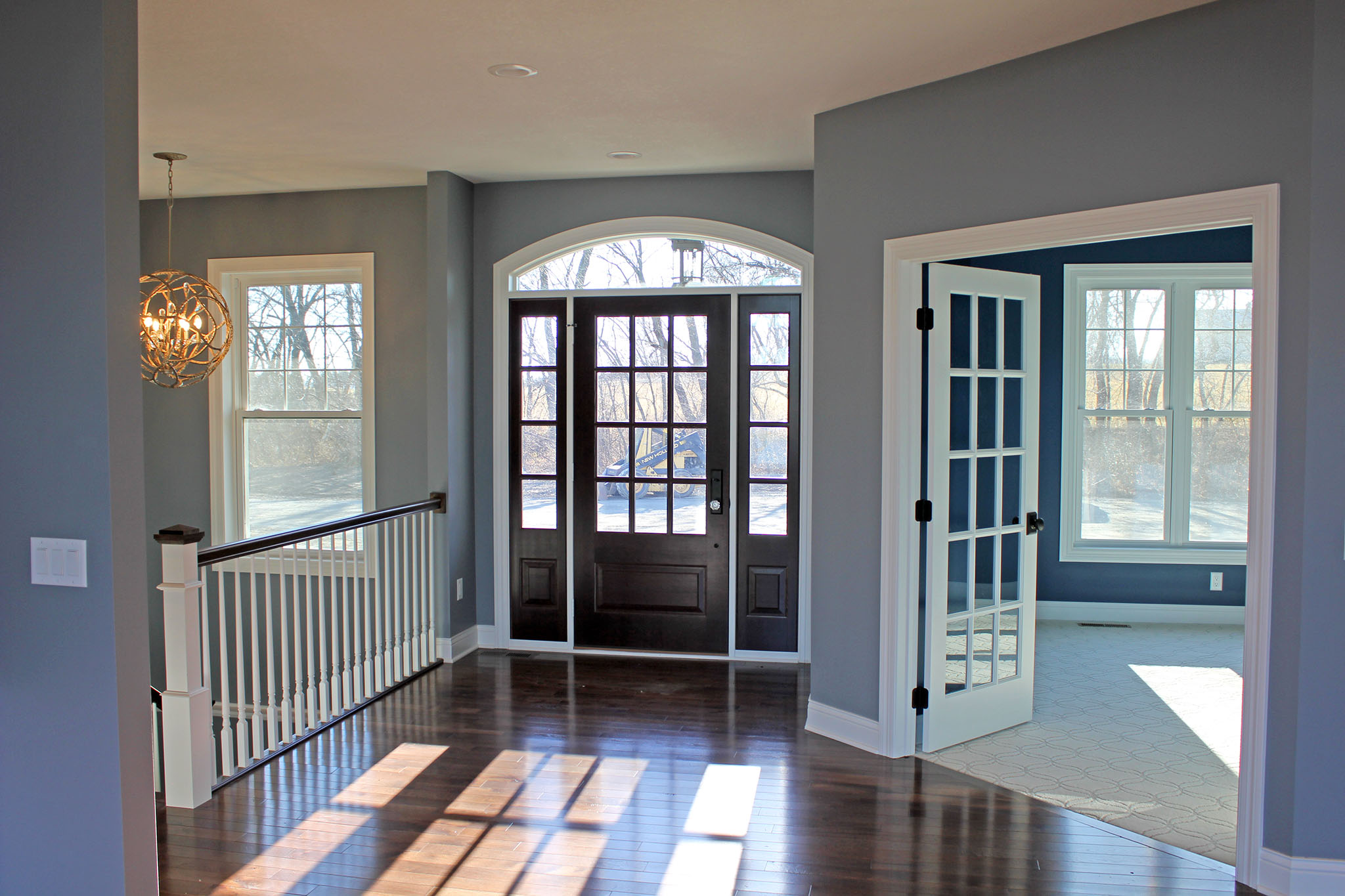 Spacious front entry with french door opening to home office