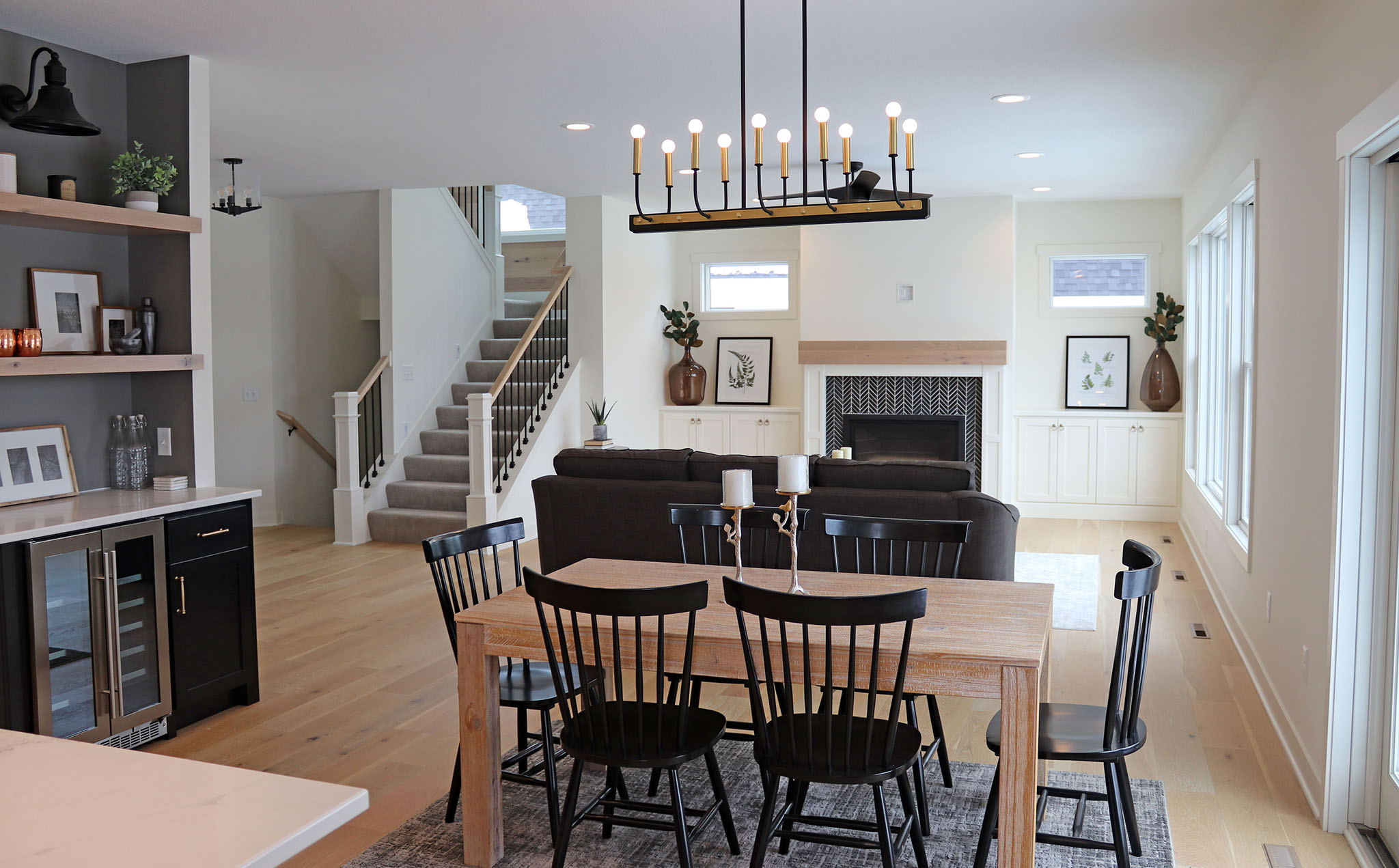 Bright, contemporary open floor plan with dining room, living room and bar nook area