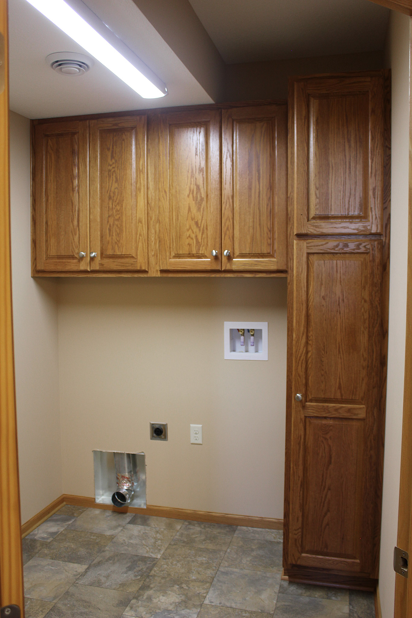 Laundry room with built-in cabinets