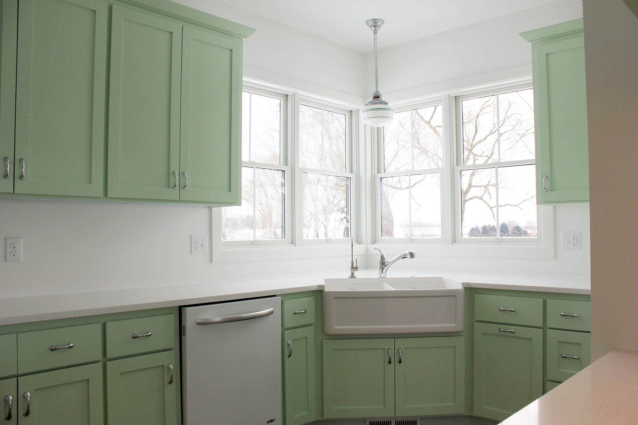 Vintage kitchen cabinets with cast iron farmhouse apron sink