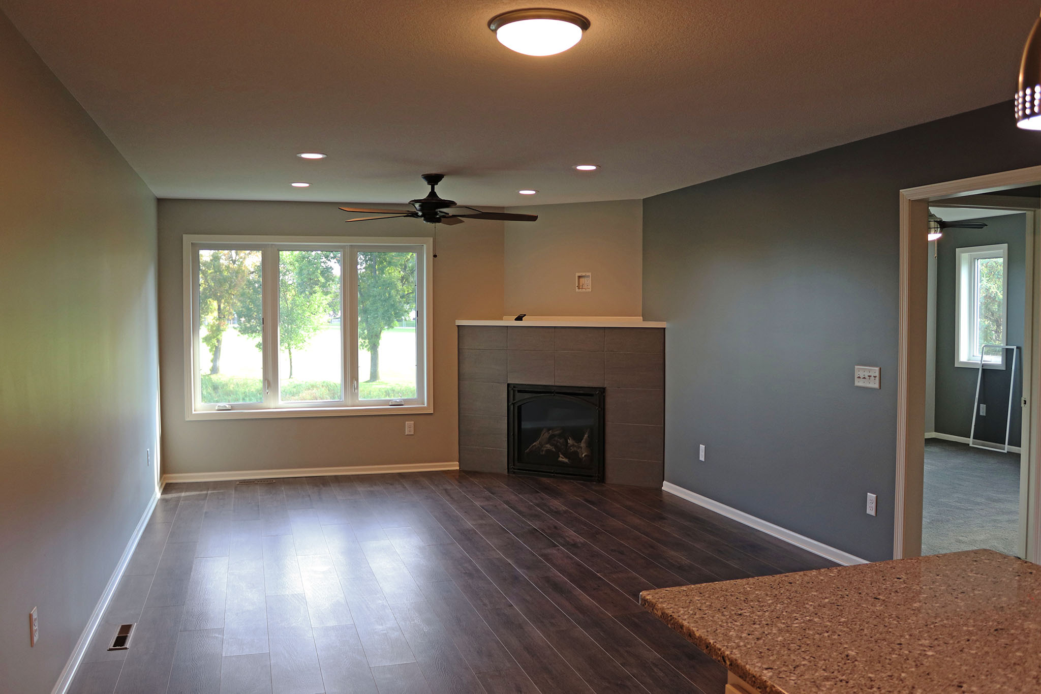 Twin home living room with fireplace