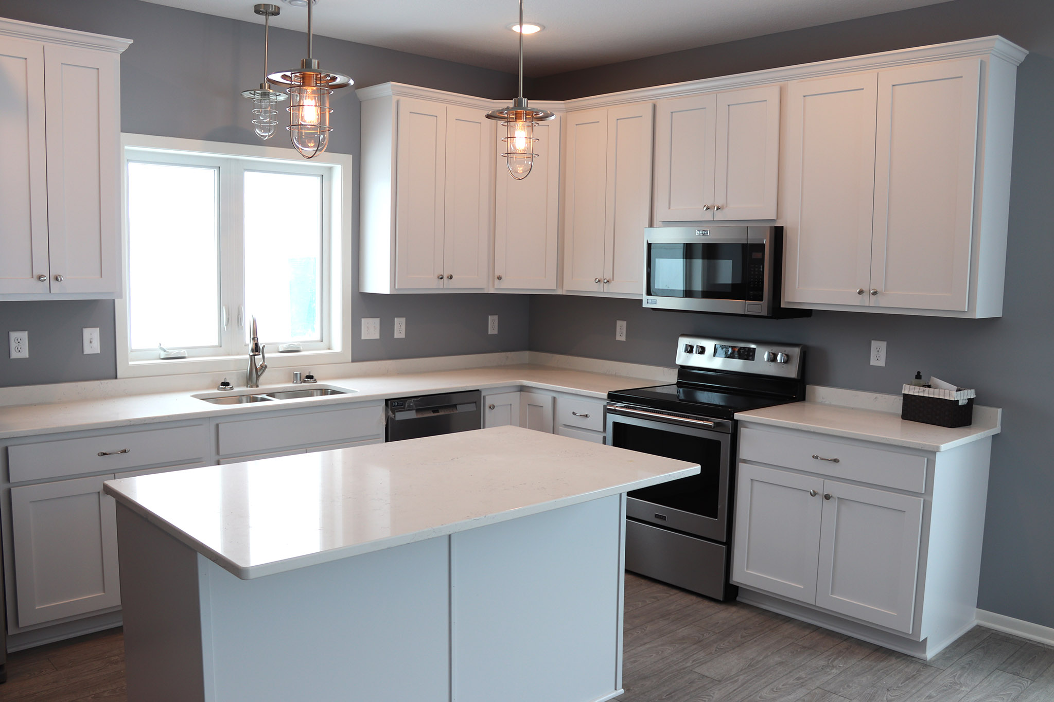 Kitchen with white cabinets and island