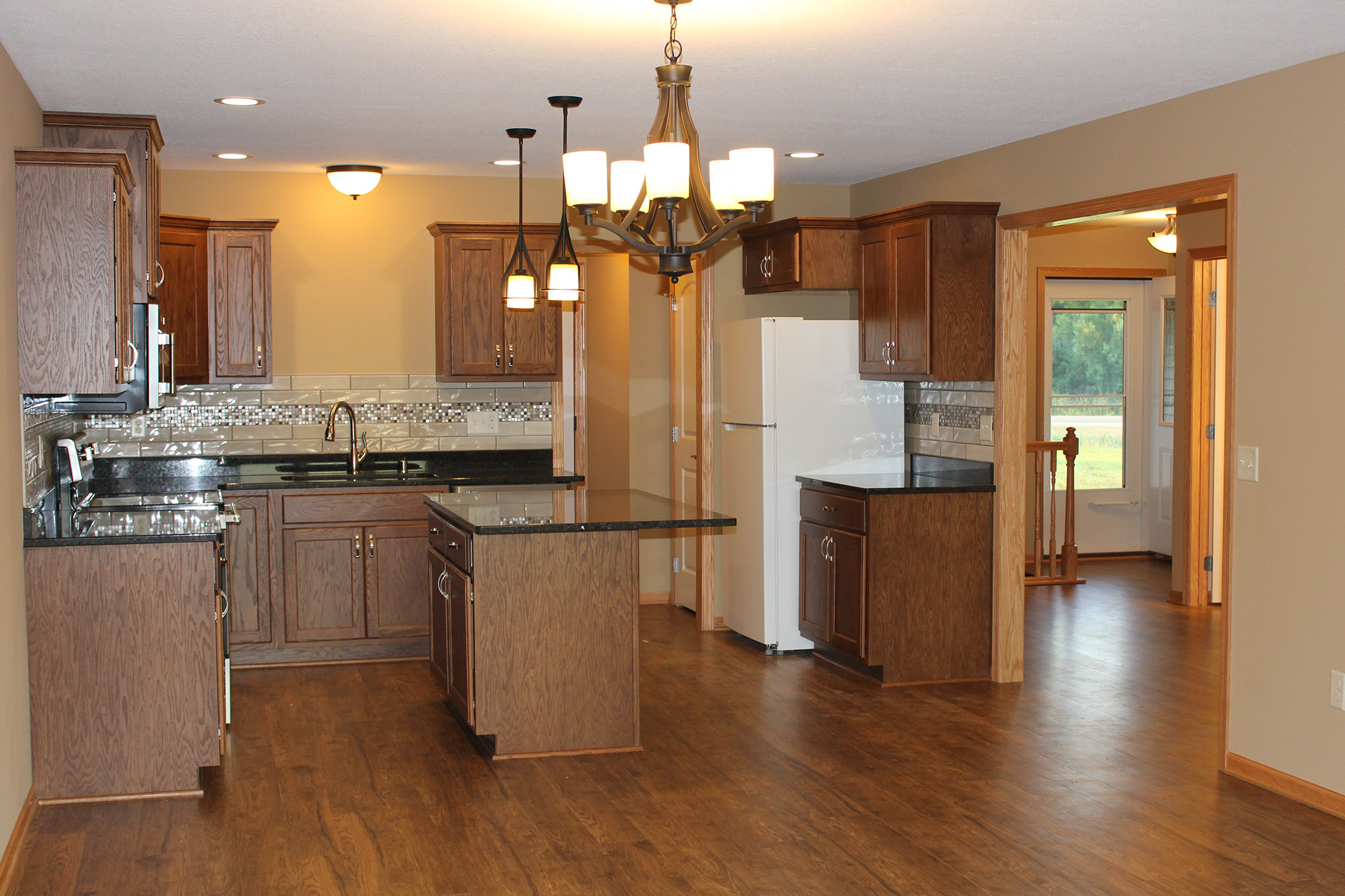 Open kitchen with island and wood cabinetry