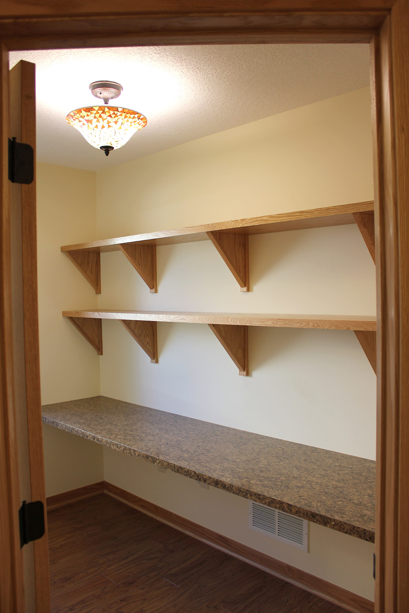 Twin home room with built-in shelving and counter