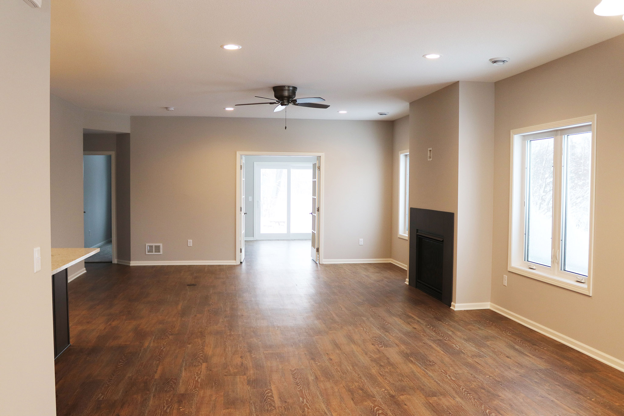 Living room with fireplace and wood floors